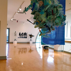 Suspended sculptures, artwear by Judy Bales/Silk banner by Rene Shoemaker